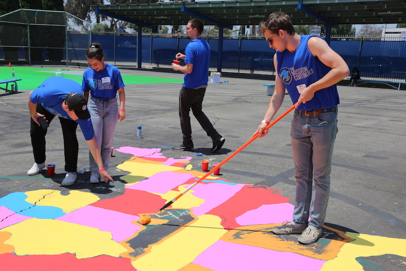 Revitalized - Created a blacktop soccer field with mobile goals, added new blacktop games, and painted vibrant murals throughout the schoolyard.