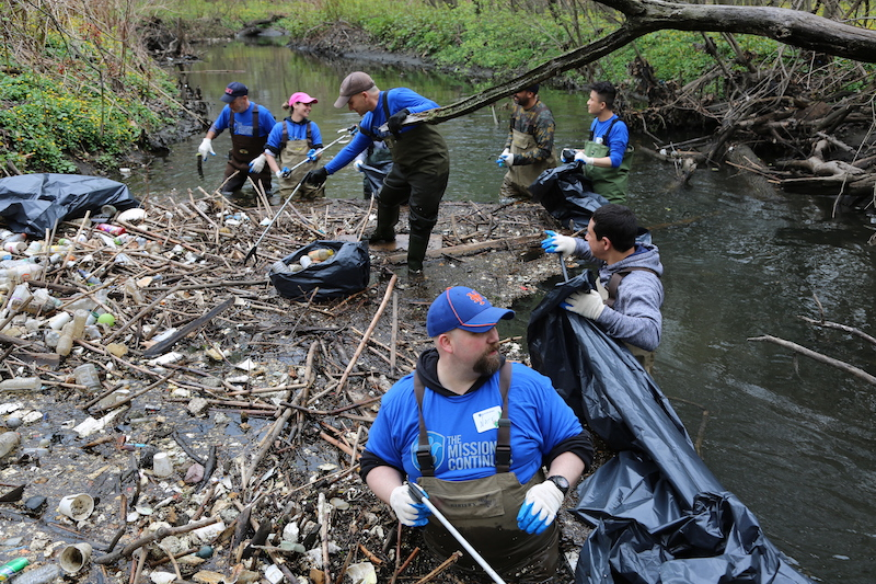 In New York, The Mission Continues volunteers clearing litter and debris from the Bronx River.
