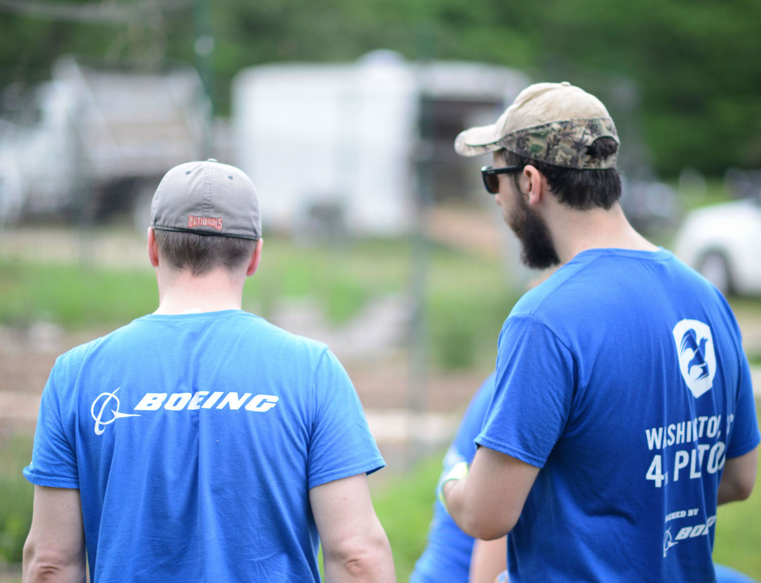 Boeing employees and Mission Continues volunteers working together at Boeing's lead sponsor project at Ft Dupont in 2017.