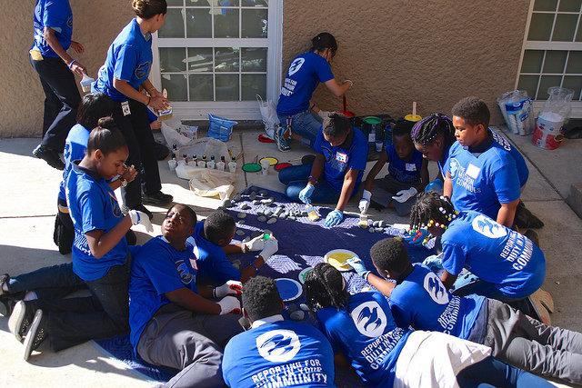 Kids and volunteers gather to paint, September 11, 2015. Photo credit: GREG CALLAN, DEMOCRACY PREP PUBLIC SCHOOLS