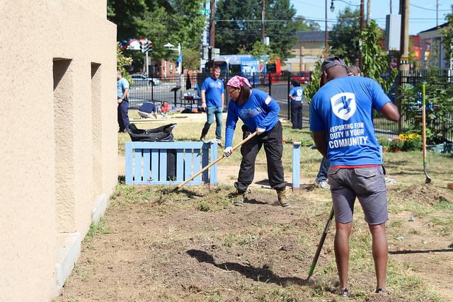Washington, DC platoon members restore the school's exterior, September 11, 2015. GREG CALLAN, DEMOCRACY PREP PUBLIC SCHOOLS