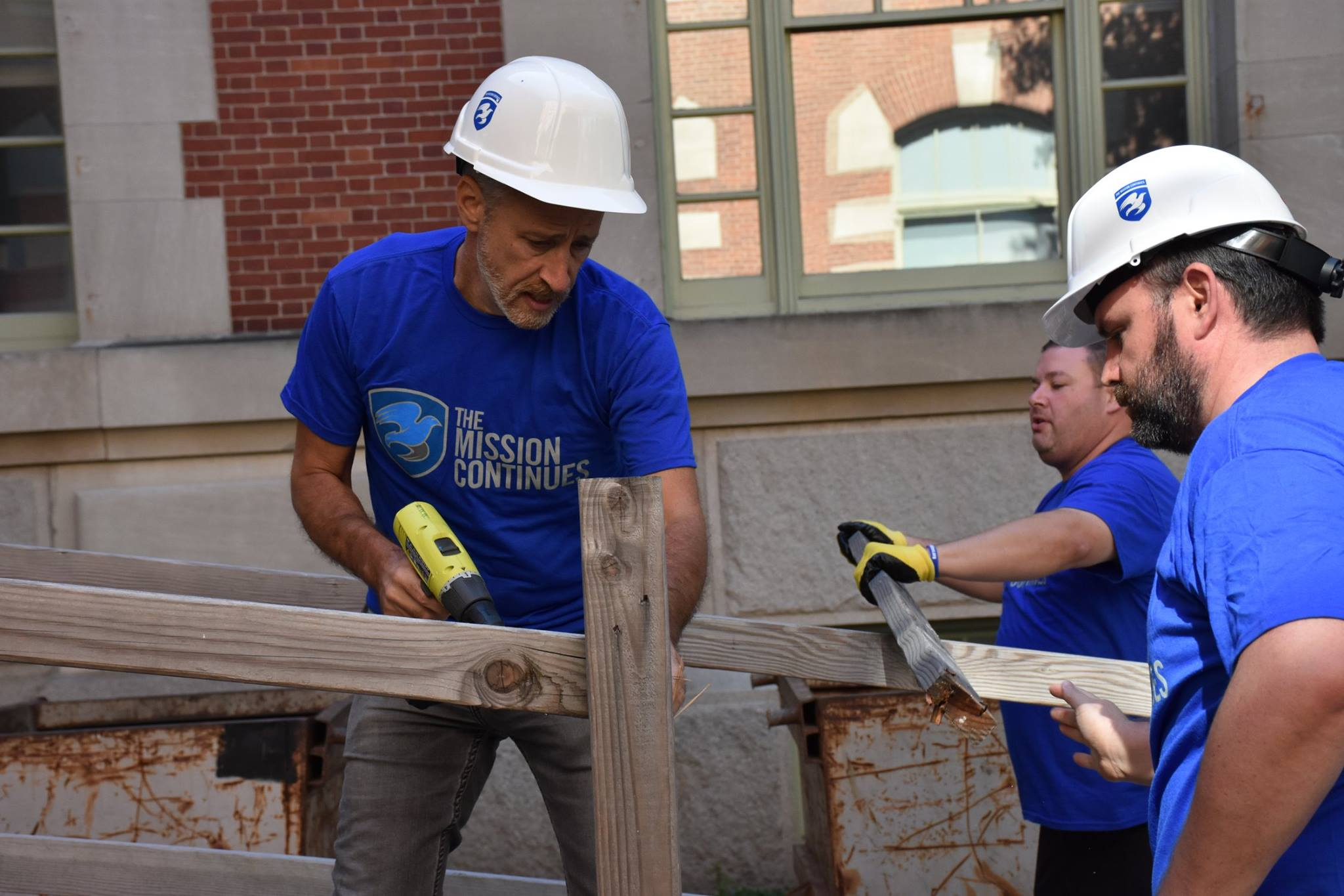 Jon Stewart and veterans with The Mission Continues serving at Ellis Island in honor of 9/11