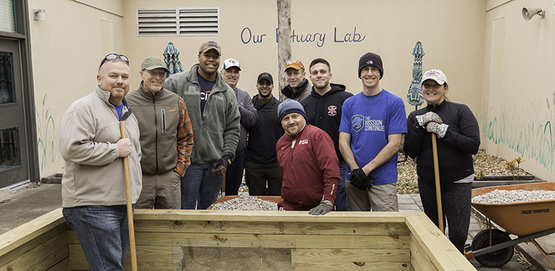 Veterans and community members work together at Mayport Elementary school just 6 days after the death of platoon member Nate Helmuth. This project was part of the national #Legacyofservice campaign.