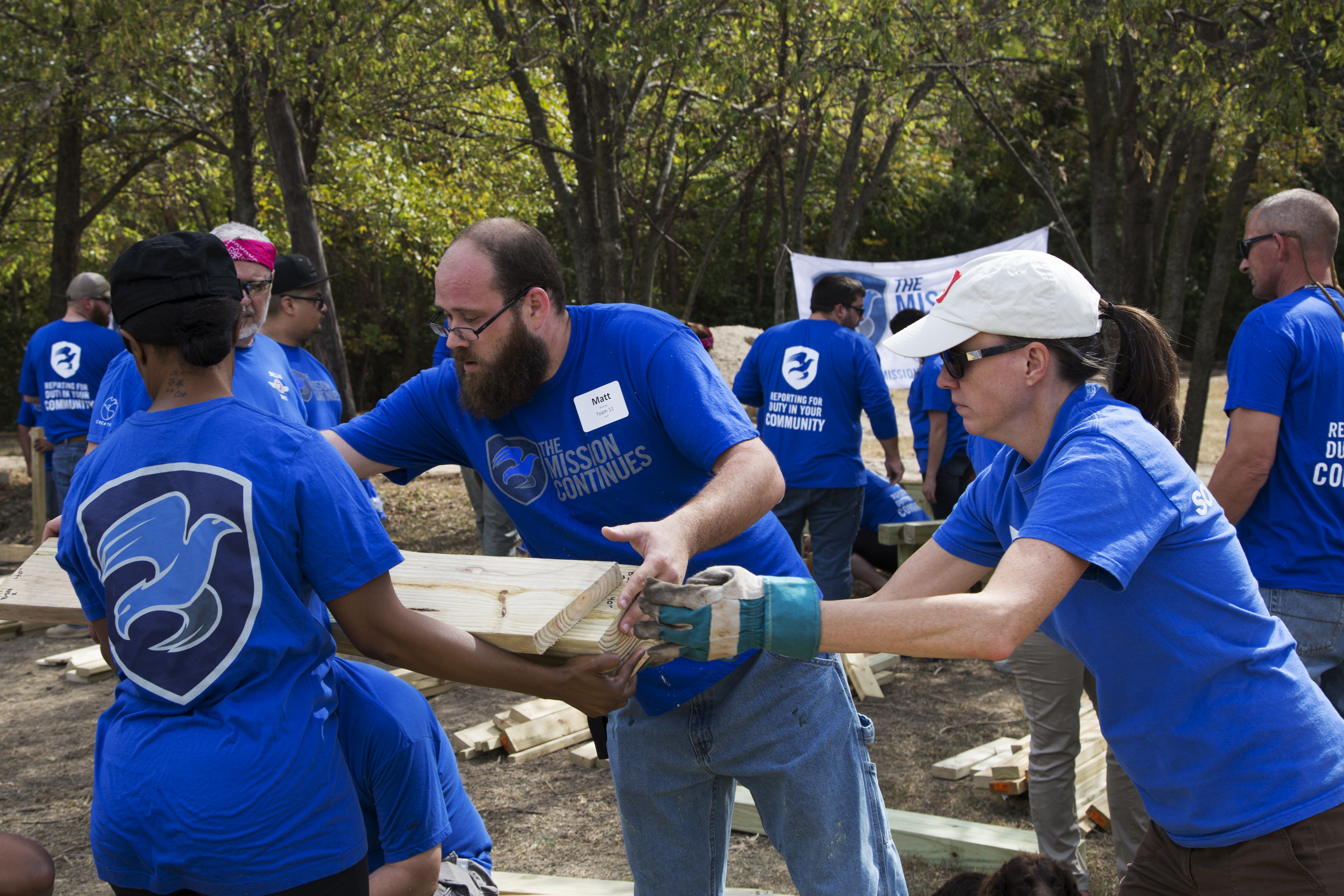 Members of Delta Class 2015 construct benches for the Avenue J facility.