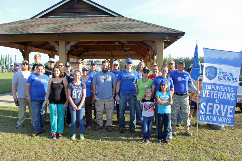 Jacksonville 1st Service Platoon gathers with WWP volunteers after the project.
